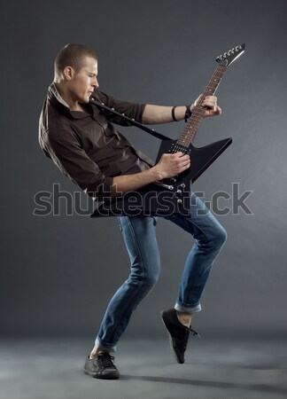 Rock rollen paar spelen elektrische gitaar schreeuw Stockfoto © feedough