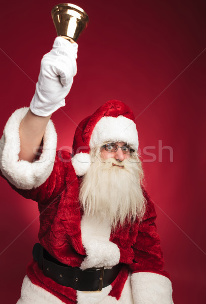 santa claus ringing his bell with hand in the air Stock photo © feedough