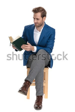relaxed stylish man with open collar sitting on wooden box Stock photo © feedough