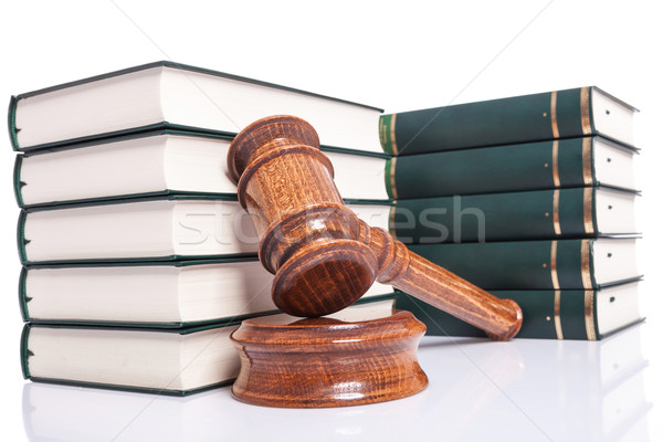 Judges wooden gavel leaning against law books Stock photo © feedough