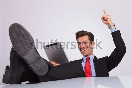 business man reads with feet on desk Stock photo © feedough