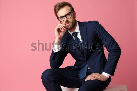 Handsome business man sitting on a stool  Stock photo © feedough