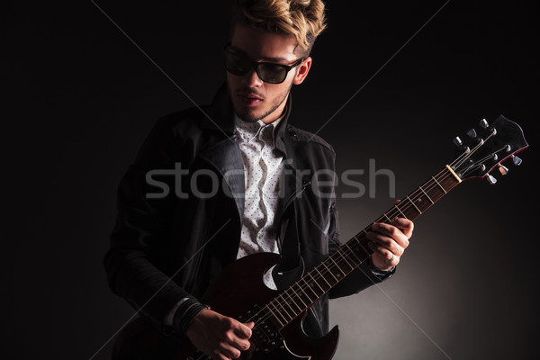 cool young guitarist playing his electric guitar Stock photo © feedough