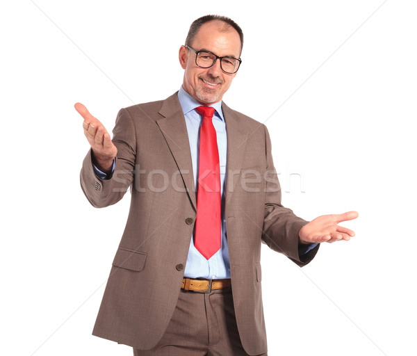 smiling old businessman welcoming you  Stock photo © feedough