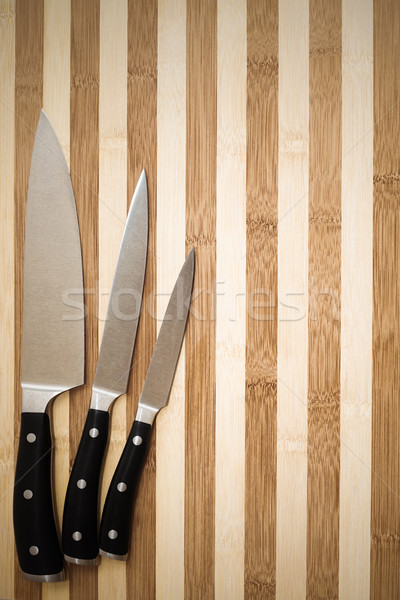 set of three professional cooking knives on cutting board Stock photo © feedough