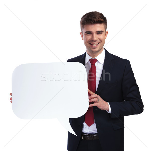 excited businessman holding a white empty speech bubble Stock photo © feedough