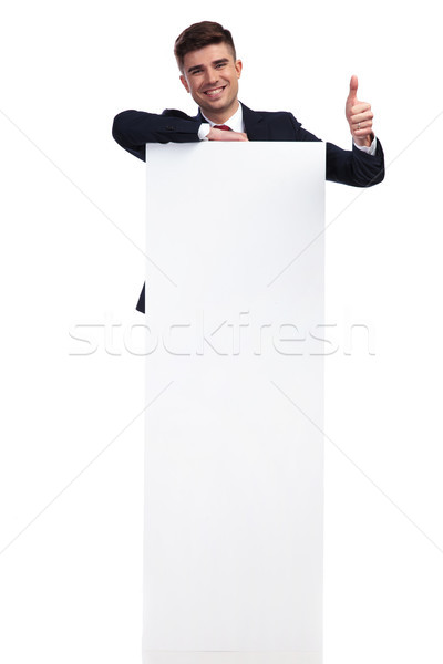 laughing businessman with mesage on board makes ok sign Stock photo © feedough