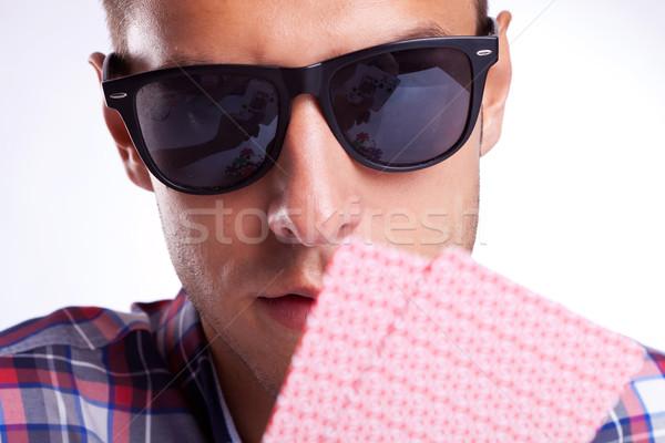 Genç kumarbaz güneş gözlüğü poker el Stok fotoğraf © feedough
