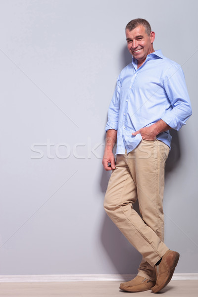casual old man stands with hand in pocket Stock photo © feedough