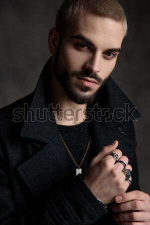 young fashion man scratching eyebrow Stock photo © feedough