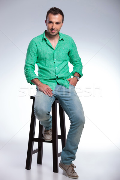 casual man sits on a high chair Stock photo © feedough