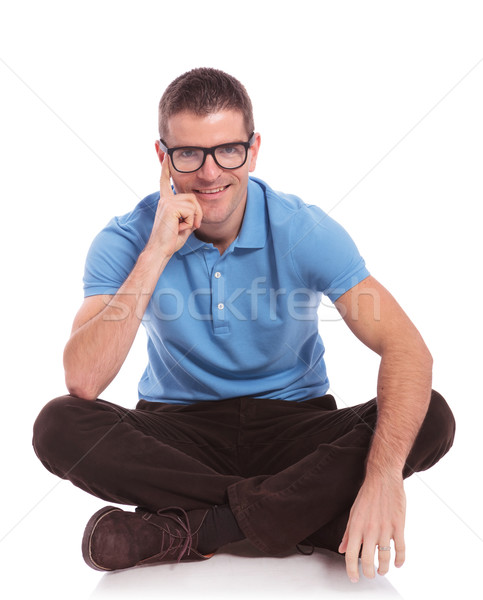seated casual man smiles with hand on cheek Stock photo © feedough