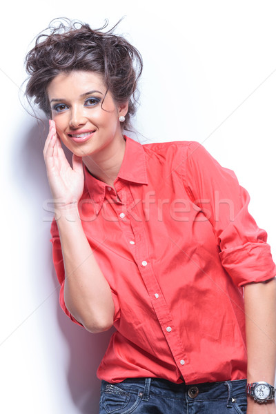 casual young woman touches face Stock photo © feedough