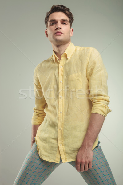 Arrogant young handsome man posing Stock photo © feedough