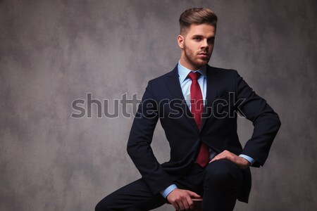 Attractive young business man looking down Stock photo © feedough