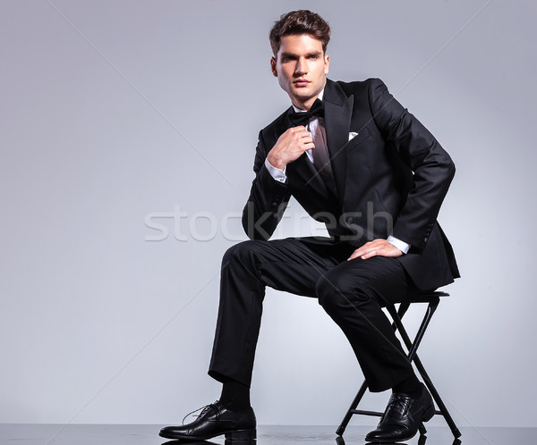 Handsome young business man fixing his bowtie Stock photo © feedough