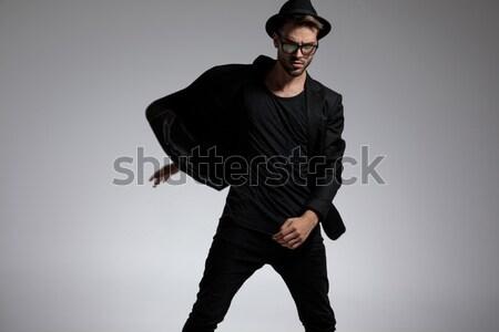чувственный модель позируют сидящий рук ног Сток-фото © feedough