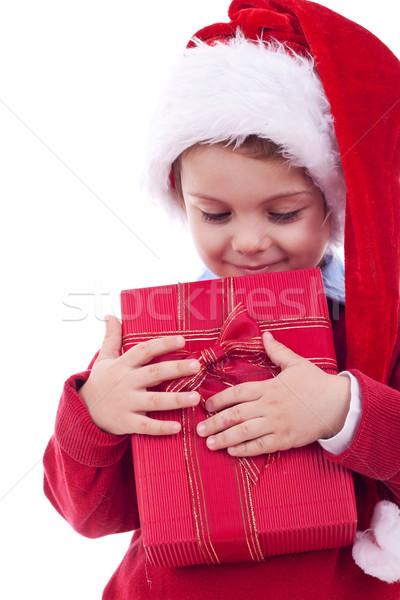 Boy holding a christmas gift Stock photo © feedough