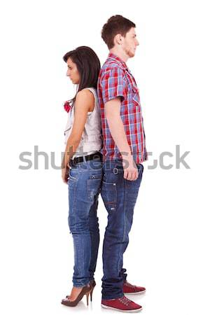 cute casual couple standing face to face Stock photo © feedough