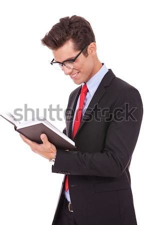 Stock photo: business man wearing glasses and reading a book