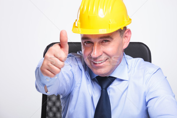 old business man with helmet shows ok Stock photo © feedough