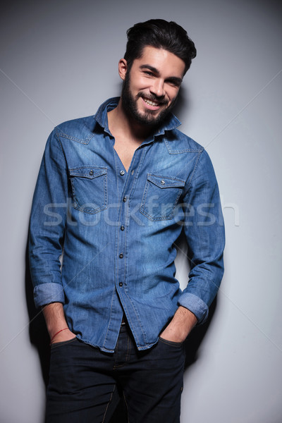 Man smiling with his hands in pocket Stock photo © feedough