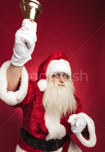 santa claus ringing bell and pointing finger Stock photo © feedough