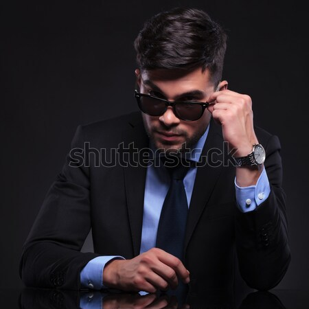 young fashion man lighting his cigarette Stock photo © feedough