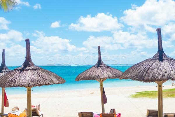 beautiful beach with deckchairs and straw umbrellas Stock photo © feedough