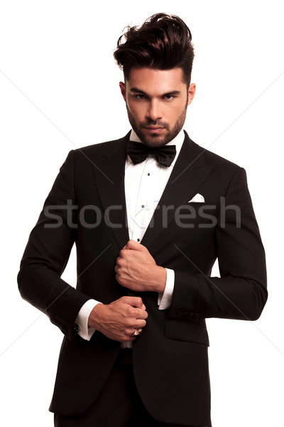 stylish man in elegant black suit and bowtie  Stock photo © feedough