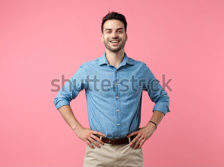 Young fashion woman holding her hands on her hips. Stock photo © feedough