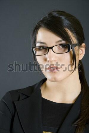 Sonriendo hombre guapo denim gafas estudio cerca Foto stock © feedough