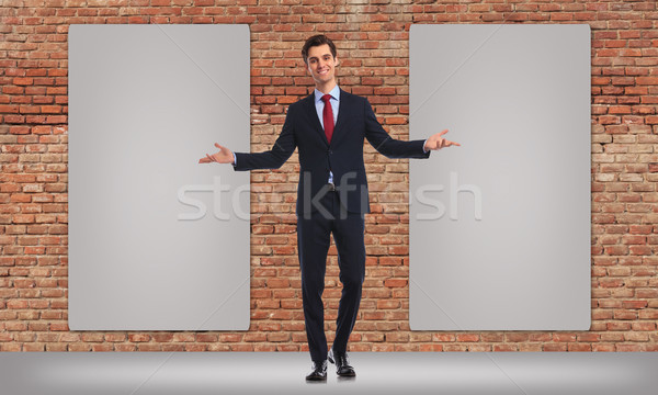 business man inviting you to see his big billboards Stock photo © feedough
