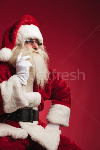 cutout image of a thoughtful santa claus sitting Stock photo © feedough
