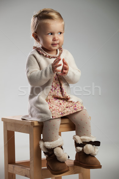 little seated girl is expecting to clap her hands  Stock photo © feedough