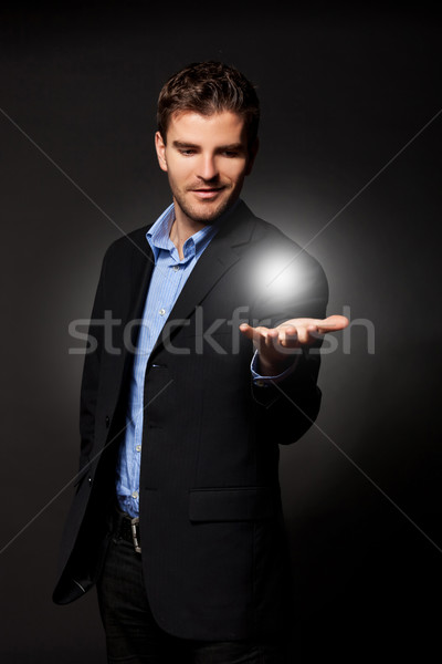 man holding the answer to all Stock photo © feedough