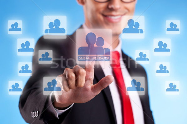 Stock photo: business mna  pressing a social network button