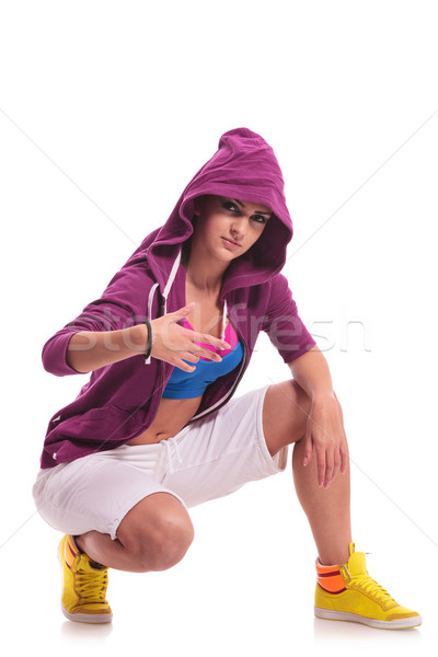 street dancer posing in crouched position Stock photo © feedough