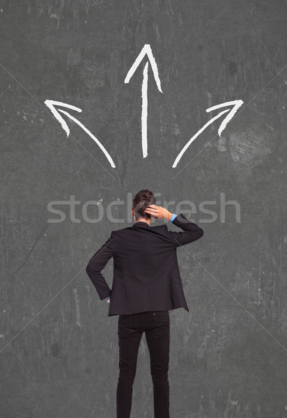 confused business man thinking wich way to go Stock photo © feedough