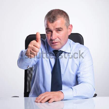 senior business man at desk points at you Stock photo © feedough