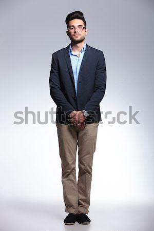 casual young man standing on gray background Stock photo © feedough