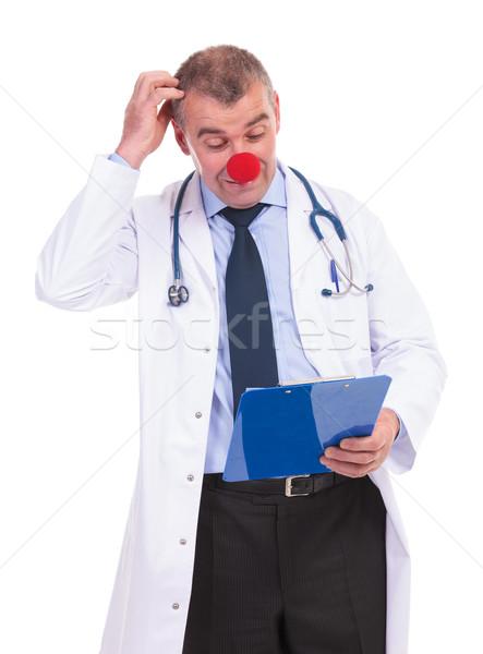 Idiot Fake Arzt Kopf Lesung etwas Stock foto © feedough