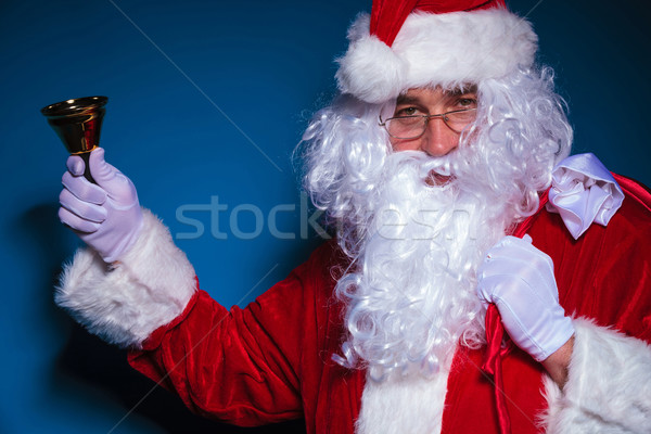 Santa Claus holding a bell in his right hand Stock photo © feedough