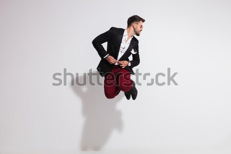 man fixing tuxedo while his lover is fluttering her dress Stock photo © feedough