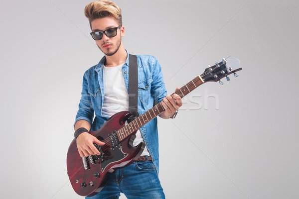 portrait of young guitarist playing guitar in studio Stock photo © feedough