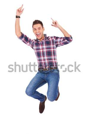 Stock photo: Handsome man jumping