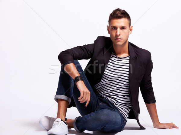 young fashion man sitting relaxed Stock photo © feedough