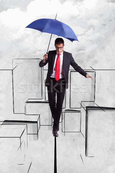 Business man in equilibrium over illustrated city Stock photo © feedough