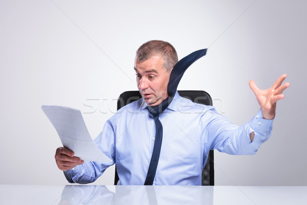 old business man blown off by documents Stock photo © feedough