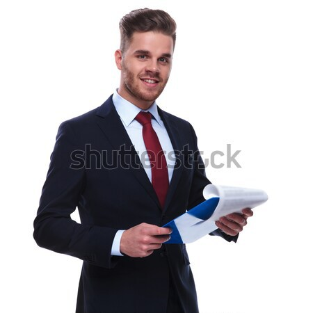 Middle aged man holding his hand in pocket Stock photo © feedough